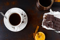 Coffee break hot fresh with chocolate on the wooden table Stock Image