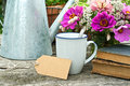 Coffee break mug old books and flowers Stock Images