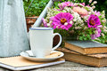 Coffee break mug watering can and flowers Royalty Free Stock Images