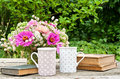 Coffee break two mugs old books and flowers Royalty Free Stock Photo