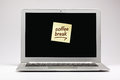 Coffee break written on sticky note on laptop screen Royalty Free Stock Image