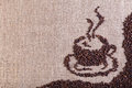 Coffee on burlap sack background with copy space Royalty Free Stock Photography