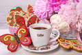Coffee and butterfly shaped gingerbread cookies cup of for summer party Royalty Free Stock Photo