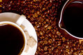 Coffee, caffee-maker over beans background Royalty Free Stock Photo