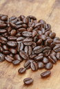 Coffee caffeine close up bean on wood Stock Photography