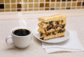 Coffee and cake tasty with raisins cup on table Stock Photography