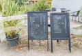 Coffee chalkboard menu located in front of the shop Royalty Free Stock Image