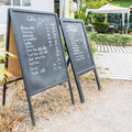Coffee chalkboard menu located in front of the shop Royalty Free Stock Images
