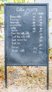 Coffee chalkboard menu located in front of the shop Royalty Free Stock Photo