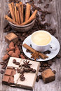 Coffee with chocolate bar and spices white cup of espresso full of on wooden table Stock Photo