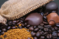 Coffee and chocolate spilled beans bars near the burlap Royalty Free Stock Images