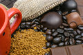 Coffee and chocolate spilled beans bars near the burlap Stock Photography
