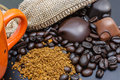 Coffee and chocolate spilled beans bars near the burlap Royalty Free Stock Photography