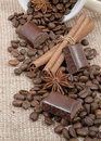 Coffee, chocolate, sticks of cinnamon, anise Royalty Free Stock Photos