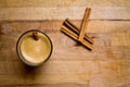 Coffee and cinnamon sticks on a wood table Stock Photos
