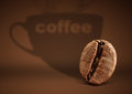 Coffee concept, bean with cup shadow on brown background