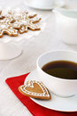 Coffee and cookie with christmas icing decorated gingerbread cookies Stock Images
