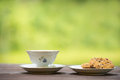 Coffee and cookie outside on wooden table Stock Photo