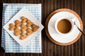 Coffee cookies with coffee in cup Royalty Free Stock Photos