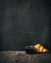 Coffee and croissant on blackboard background copy space Stock Photography