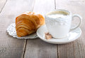 Coffee and croissant on wooden background Stock Photo