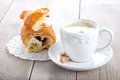Coffee and croissant on wooden background Royalty Free Stock Images