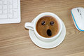 Coffee cup with astonished expression in in cream coffee funny concept Royalty Free Stock Images