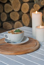 Coffee cup on bar table and romantic candles closeup Royalty Free Stock Photo