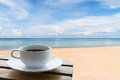 Coffee cup on the beach Royalty Free Stock Photo