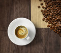 Coffee cup and beans on burlap Stock Photo