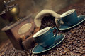 Coffee cup, beans and old grinder Royalty Free Stock Photo