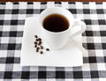 Coffee cup and beans on a table Stock Photo