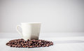 Coffee cup and beans on white background Royalty Free Stock Photos