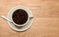 Coffee cup and beans a of with on a wooden background Royalty Free Stock Photos
