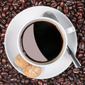 Coffee cup biscuits and beans. Royalty Free Stock Photo