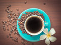 Coffee cup a of black with beans Stock Images