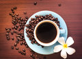 Coffee cup a of black with beans Stock Photos