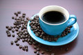 Coffee cup a of black with beans Royalty Free Stock Image