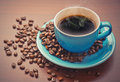 Coffee cup a of black with beans Royalty Free Stock Images