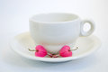 Coffee cup with bleeding heart flower Royalty Free Stock Photo