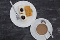 Coffee cup with blueberry cheesecake on white dish classic table Stock Photo