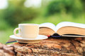 Coffee Cup And Book On Wood