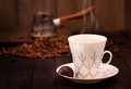 Coffee cup and brewing pot of with beans still life Royalty Free Stock Images