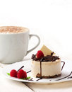 Coffee and cup cake with cream with raspberry chocolate on wooden white background Stock Images