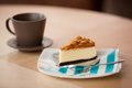 Coffee cup and cake a plate with Royalty Free Stock Image