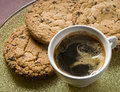 Coffee cup and chocolate cookies Royalty Free Stock Photography