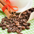 Coffee cup, cinnamon sticks and coffee beans Royalty Free Stock Photos