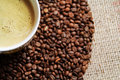 Coffee cup on coffee bean background Royalty Free Stock Photo
