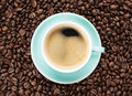 Coffee cup on coffee beans Stock Image