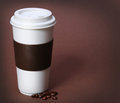 Coffee cup with Coffee Beans on brown background. Takeaway Royalty Free Stock Photo